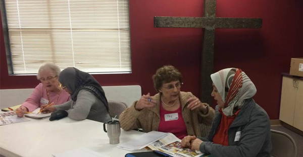 Church volunteers, from left, Pat Lehnen, Hanaa Almusawi, Peg Leclercq, Huda Al Boalwan practice conversational English at First Covenant Church of Sacramento. (Courtesy of First Covenant Church)