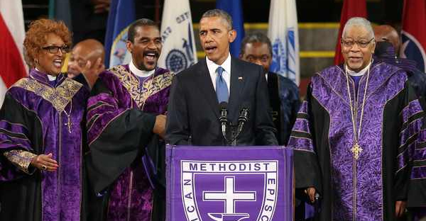 """President Barack Obama sings """"Amazing Grace"""" as he delivers the eulogy for South Carolina state senator and Rev. Clementa Pinckney during Pinckney's funeral service June 26, 2015 in Charleston, South Carolina. (Joe Raedle/Getty Images North America)"""
