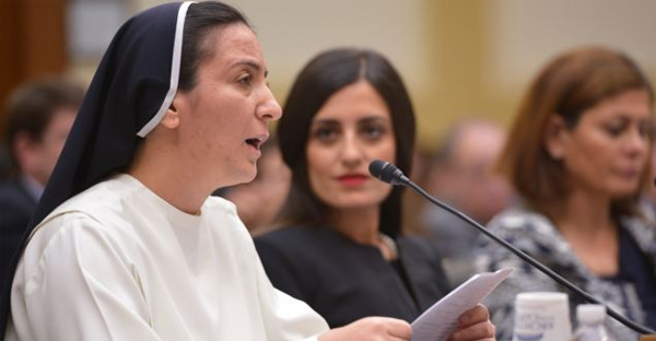 Sister Diana Momeka, a Roman Catholic nun driven out of a convent in Mosul, Iraq, testifies before the House Foreign Affairs Committee during a hearing on IS persecution of religious minorities, on Capitol Hill May 13, 2015. (AFP)