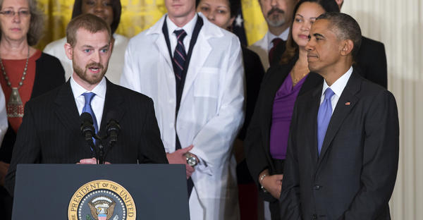Ebola survivor Dr. Kent Brantly, left, introduces President Barack Obama during an event with American health care workers fighting the Ebola virus Wednesday, Oct. 29, 2014, in the East Room of the White House in Washington. (Evan Vucci, Associated Press)