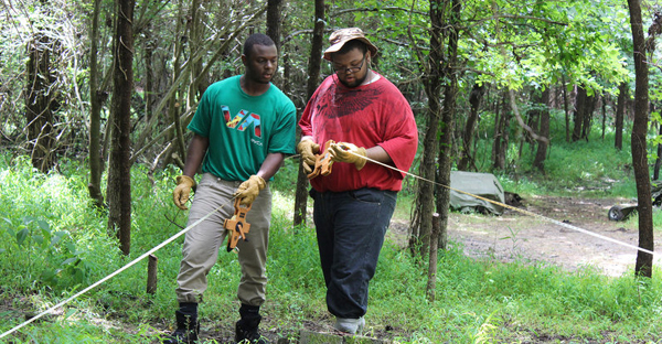 Kalen Gilliam (left) and Justis Jackson take measurements at the Urban Archaeology Corps excavation site about 10 miles outside of Richmond, Va. (Catherine Cozzi/Groundwork RVA)
