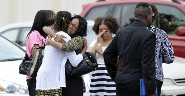 Parishioners comfort each other after attending an early Sunday morning service at Nations Ford Community Church on Sunday, August 30, 2015. Bishop Phillip Davis of Nations Ford Community Church was found dead in his Union County home Saturday, Aug. 28. (David T. Foster III)