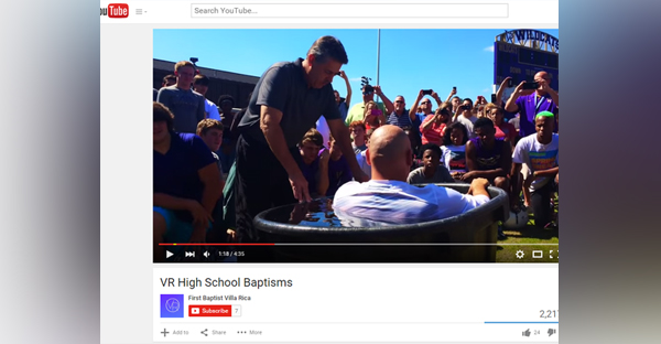 A YouTube video shows a mass baptism at Villa Rica High School from August 17th. (Photo: YouTube)