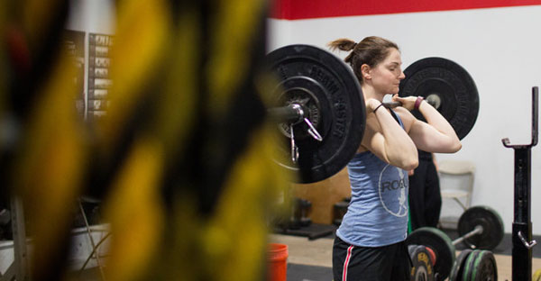 "Ali Huberlie at CrossFit Boston in Brighton, Mass. ""CrossFit is family, laughter, love and community,"" she said. (Adam Glanzman for The New York Times)"