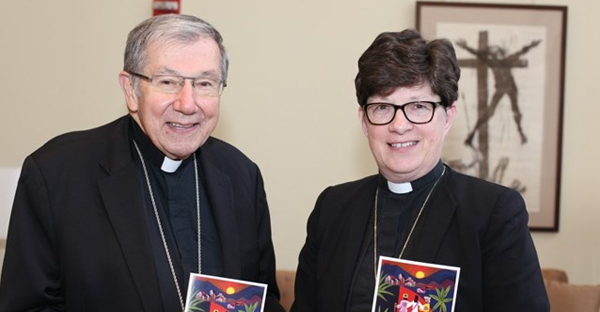 Bishop Denis Madden, auxiliary of Baltimore and Rev. Elizabeth Eaton, presiding bishop of the Evangelical Lutheran Church of America hold copies of 'Declaration on the way: Church, Ministry and Eucharist' (Photo courtesy of ELCA)