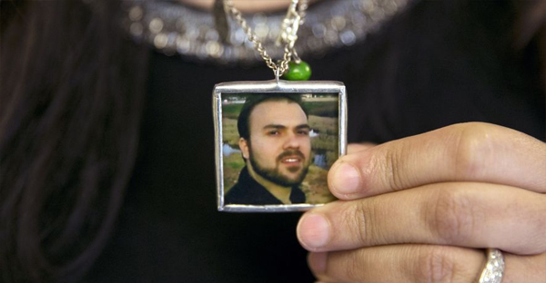 Naghmeh Abedini holds a necklace with a photograph of her husband, Saeed Abedini, on Capitol Hill on June 2, 2015 during a House Foreign Affairs Committee hearing with four people whose family members were being held in Iran. (Jacquelyn Martin, Associated Press)