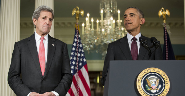(L-R) Secretary of State John Kerry looks on as U.S. President Barack Obama makes a statement after meeting with his National Security Council at the State Department, February 25, 2016 in Washington, DC. (Drew Angerer/Getty Images North America)