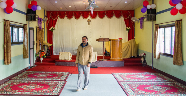 Tej Rokka is a Nepali pastor who works with the evangelical group Climbing for Christ. He's standing inside Savior Alone Redeems Asians church, in Kathmandu, where he preaches. (Sworup Nhasiju)