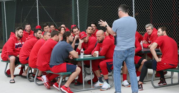 St. Louis Cardinals chaplain Darrin Patrick holds a Sunday morning chapel service for players, coaches and staff outside the clubhouse batting cages during St. Louis Cardinals spring training on Sunday, Feb. 21, 2016, at Roger Dean Stadium in Jupiter, Fla. (Photo by Chris Lee, clee@post-dispatch.com)