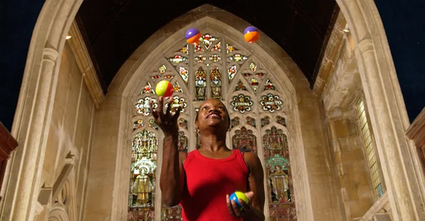 A performer juggling at the Circomedia circus training school based in St Paul's church in Bristol. (Photograph: Jeff Morgan/Alamy)