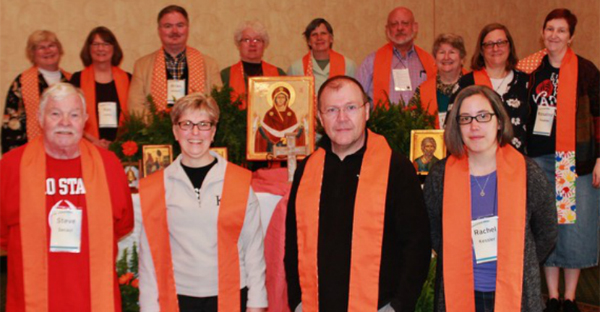 Clergy from the Episcopal Diocese of Ohio wear orange stoles ahead of Wear Orange Sunday on June 5, 2016. Back row: Mary L. Staley of St. Paul's, Put-in-Bay; Kay N. Ashby of St. Matthew's, Ashland; Brian K. Wilbert of Christ Church, Oberlin; June Hardy Dorsey of St. Andrew's, Elyria; Beth Frank of New Life, Uniontown; C. Eric Funston of St. Paul's, Ohio; Sarah Shofstall of St. Barnabas, Bay Village; Gayle L. Catinella of St John's, Youngstown; Rosalind Hughes of Epiphany, Euclid. Front Row: Stephen Secaur of St. Bartholomew, Mayfield Village; Mary C. Carson of Redeemer, Lorain; Christopher McCann of St. Luke's, Chardon; Rachel C. Kessler of Harcourt Parish, Gambier. (Photo courtesy of the Rev. Jeff Bunke, Perrysburg, Ohio)