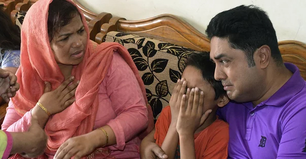 The son of Mahmuda Begum, whose husband led several operations against a banned militant group, mourns in Chittagong. (Photograph: AFP/Getty)