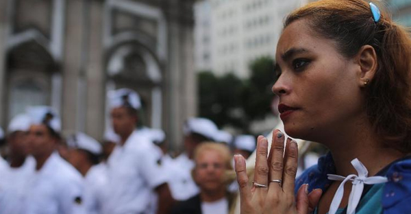 Women who attend religious services, especially Catholic women, are much less likely to commit suicide, says a new study. (Mario Tama / AFP/Getty Images)