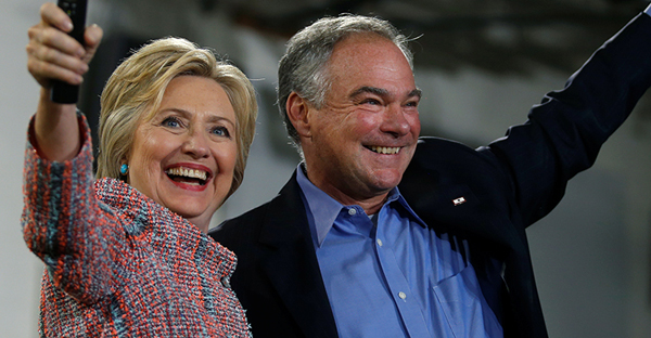 Democratic presidential candidate Hillary Clinton and U.S. Sen. Tim Kaine, D-Va., wave to the crowd during a campaign rally at Ernst Community Cultural Center in Annandale, Va., on July 14, 2016. (Courtesy of REUTERS/Carlos Barria)