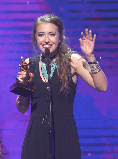 "The night's leading winner Lauren Daigle accepting ""Artist of the Year"" award (Photo credit: Terry Wyatt, Getty Images)"