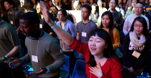 Worshipers at the Urbana conference in St. Louis sponsored by the InterVarsity Christian Fellowship, one of the country's leading campus Christian organizations. (Credit: Paul M. Walsh/The Leader-Telegram, via Associated Press)