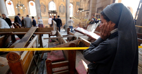 A nun cries as she stands at the scene inside Cairo's Coptic cathedral, following a bombing, in Egypt December 11, 2016. (Amr Dalsh)