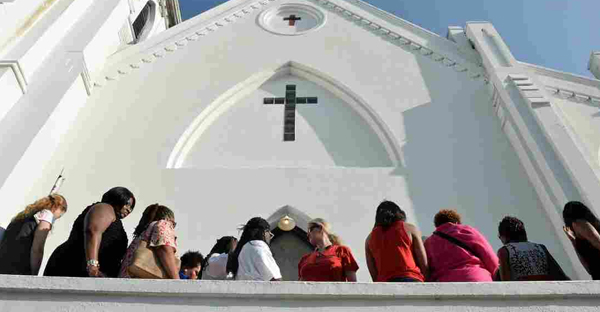 People line up to enter for Sunday service at the Emanuel AME Church in Charleston, S.C. (Mladen Antonov/AFP/Getty Images)