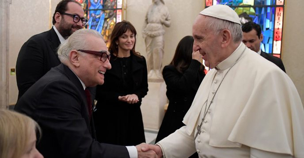 "Pope Francis shakes hands with director Martin Scorsese, left, on the occasion of their private audience at the Vatican, Wednesday, Nov. 30, 2016. Francis met with Scorsese, whose new film, ""Silence,"" about Jesuit missionaries in 17th-century Japan, was screened this week in Rome. (Credit: L'Osservatore Romano/Pool Photo via AP)"