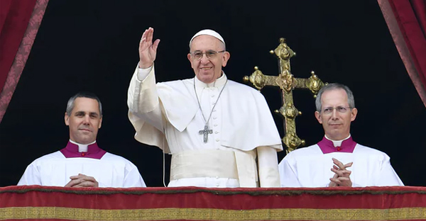 Pope Francis waves from the balcony of St Peter's during his Christmas message to the city and the world. (Photograph: Andreas Solaro/AFP/Getty Images)