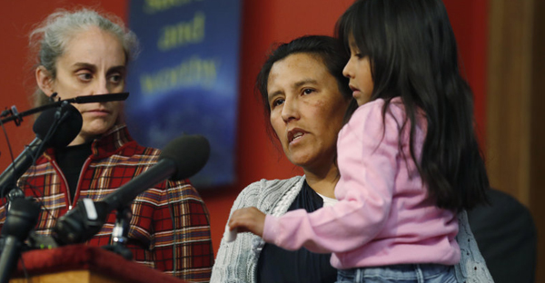 Jeanette Vizguerra, a Mexican woman seeking to avoid deportation from the United States, speaks Wednesday as she holds her 6-year-old daughter, Zuri, during a news conference in a Denver church in which Vizguerra and her children have taken refuge. (David Zalubowski/AP)