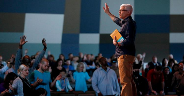 Pastor David Daniels prays with the congregation at the conclusion of a service at Pantego Bible Church in Fort Worth. (Gary Coronado / Los Angeles Times)