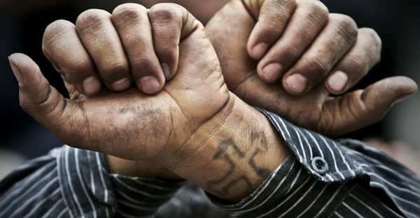 In this Friday, April 14, 2006 file photo, Egyptian Copts cross their wrists in defiance outside the Saints Church in the Sidi Bishr district of Alexandria in Egypt. (AP Photo/Ben Curtis, File)