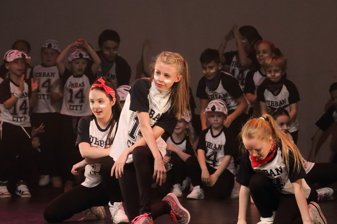 Urban City Dancers pose at the end of one of their street dance numbers