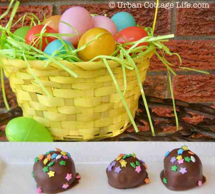 Several star-sprinkled chocolate balls on a plate in front of a yellow basket filled with brightly coloured plastic eggs