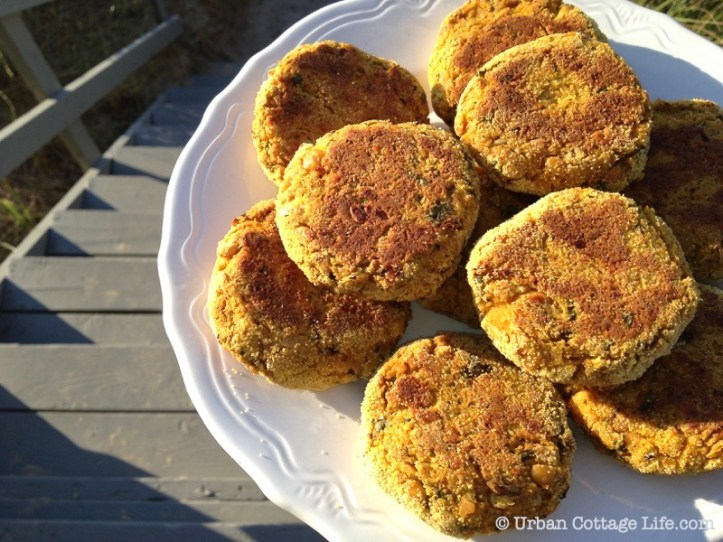 A plate of Butternut Squash and Chickpea Cakes overlooking a wooden staircase