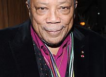 "Quincy Jones Music Producer(Jones was the producer, with Michael Jackson, of Jackson's albums Off the Wall (1979), Thriller (1982), and Bad (1987), as well as being the producer and conductor of the 1985 charity song ""We Are the World"".)"