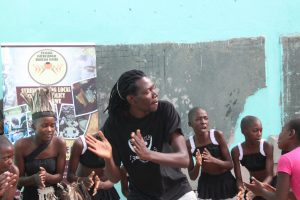Charles Banda of Sunduza leads a dance session