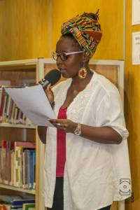 Lady tshawe reading a chapter from the book