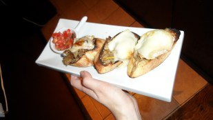 Imported Tallegio cheese on crostinis with house made burschetta