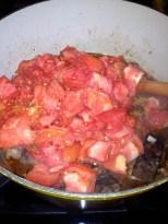 Adding tomatoes.