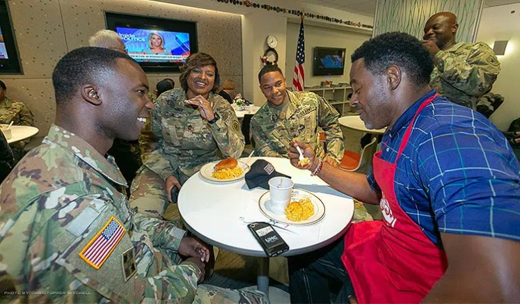 USO members have lunch with actor Lamman Rucker (Credit: Chris Mitchell/OWN)