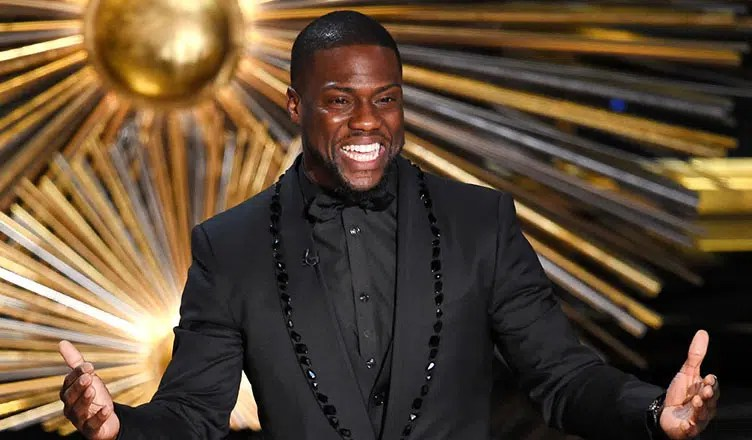 Kevin Hart on stage at the Oscars. (Credit: Oscars.com)