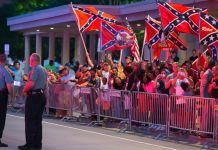 Who But A Racist Would Waive The Confederate Flag At the First Black President's Motorcade? 2