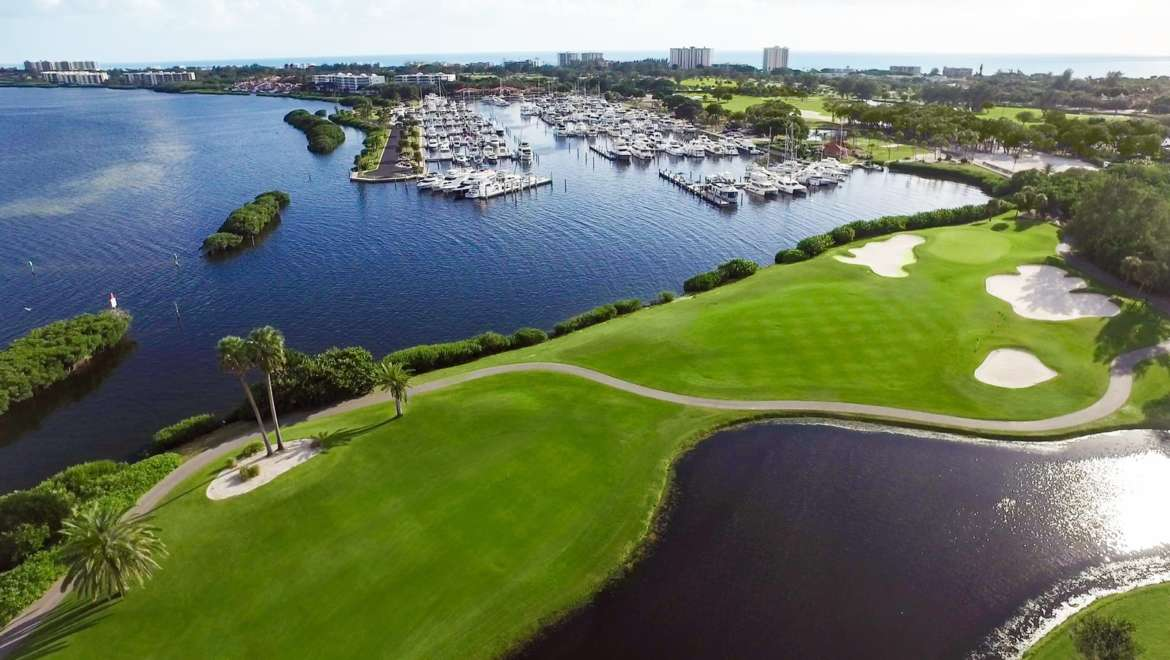 aerial view of golf course and marina