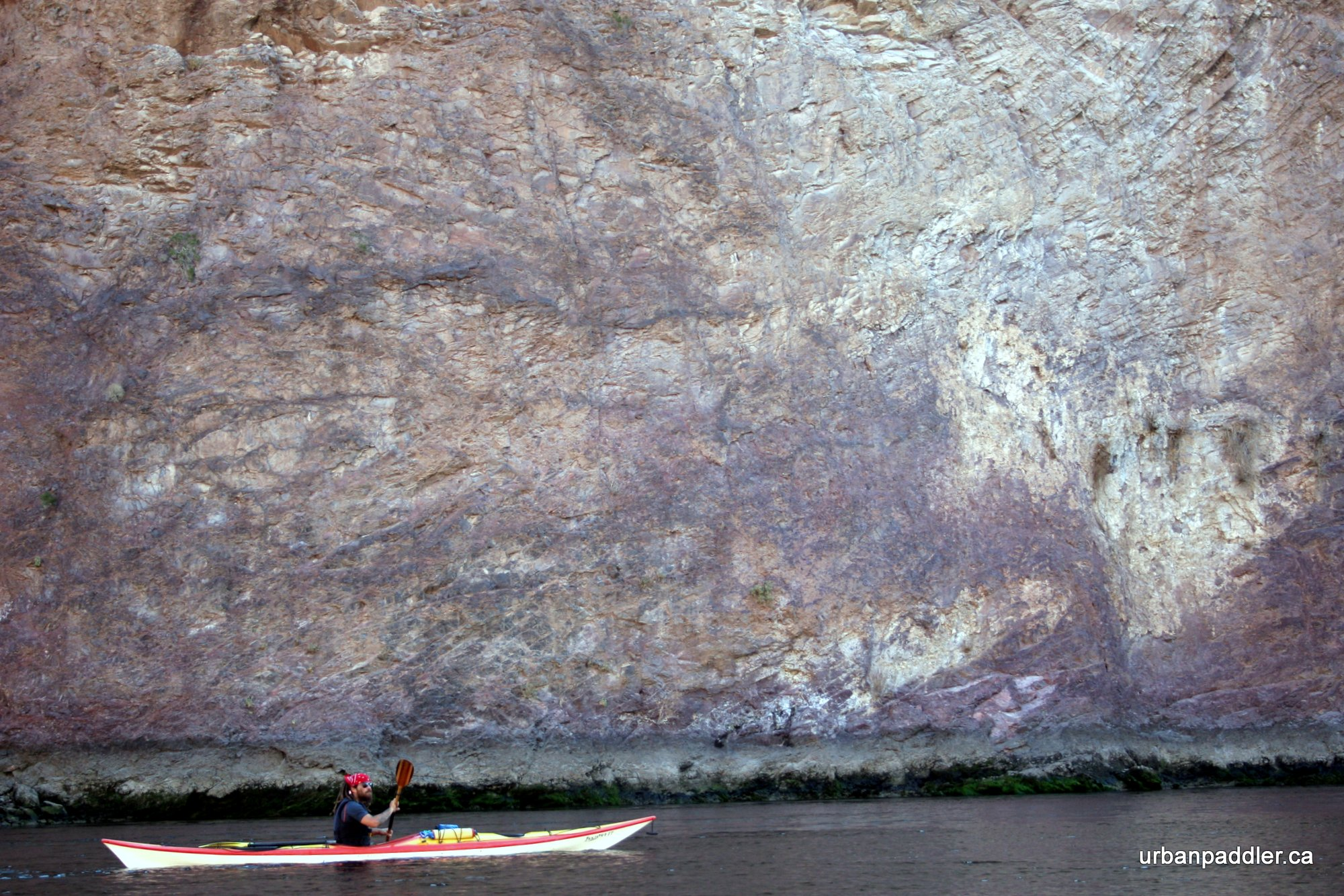 Antonio, our guide, kayaking beside a sheer rock wall in the canyon.