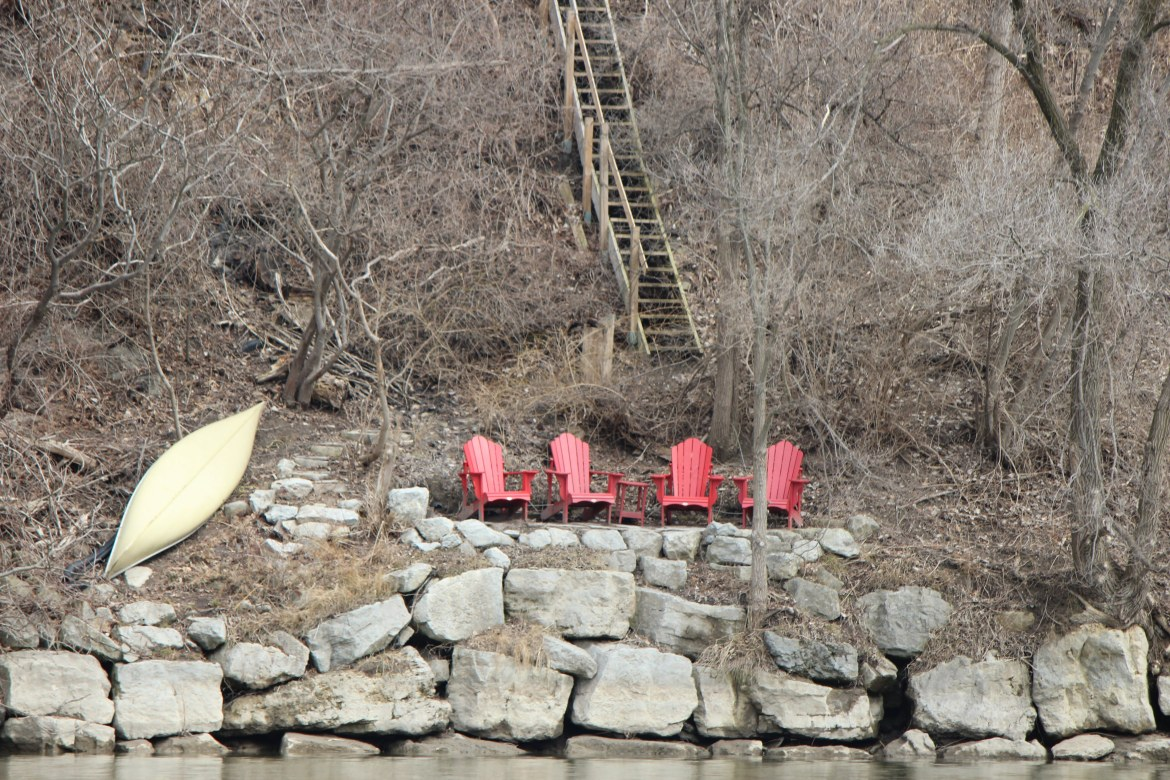 Muskoka chairs and steep stairs leading to a Swansea mansion up on the cliff of the Humber River in Toronto