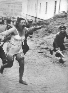 Jewish woman being chased by youth armed with clubs