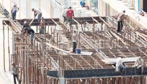 Construction workers lament pay gap, labour laws
