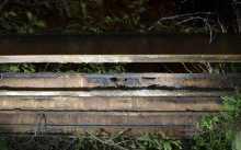 Some rusty steel girders above the concrete slipway.