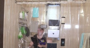 Shower curtain holds your electronics