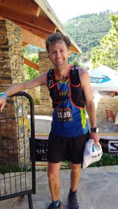 Still smiling after finishing a 100k race in the mountains