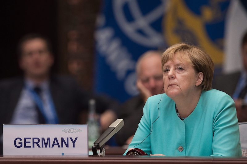 epa05523604 German Chancellor Angela Merkel listens to Chinese President Xi Jinping speech during the opening ceremony of the G20 Leaders Summit in Hangzhou on September 4, EPA/NICOLAS ASFOURI