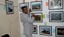 Mr Sundat Odita admiring his works in his photograhpy studio