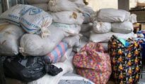 Sacks of canabis and bags of cocaine recovered by NDLEA officials during raid on Lagos hard drug haven