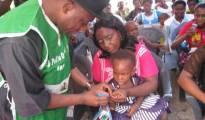 Rivers State Governor, Hon Chibuike Amaechi immunising a baby during immunisation  campaign programme